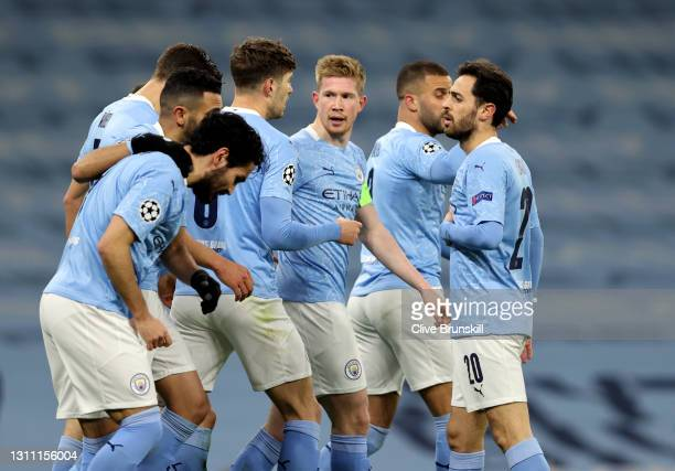 Kevin De Bruyne of Manchester City celebrates with teammates after scoring their team's first goal during the UEFA Champions League Quarter Final...