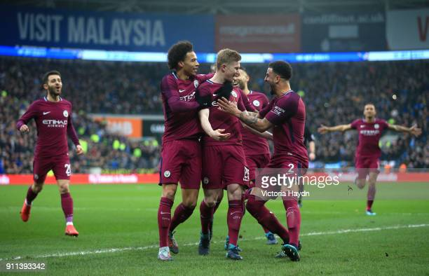 Kevin De Bruyne of Manchester City celebrates with teammates after scoring his sides first goal during The Emirates FA Cup Fourth Round match between...