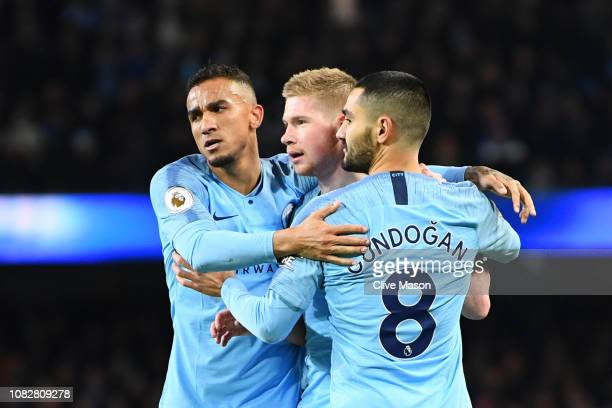Kevin De Bruyne of Manchester City celebrates with teammates Danilo and Ilkay Gundogan of Manchester City as Conor Coady of Wolverhampton Wanderers...