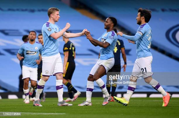 Kevin De Bruyne of Manchester City celebrates with teammates Raheem Sterling and David Silva after scoring his team's second goal during the Premier...