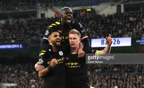 Kevin De Bruyne of Manchester City celebrates with teammates Riyad Mahrez and Benjamin Mendy after scoring his team's second goal during the UEFA...