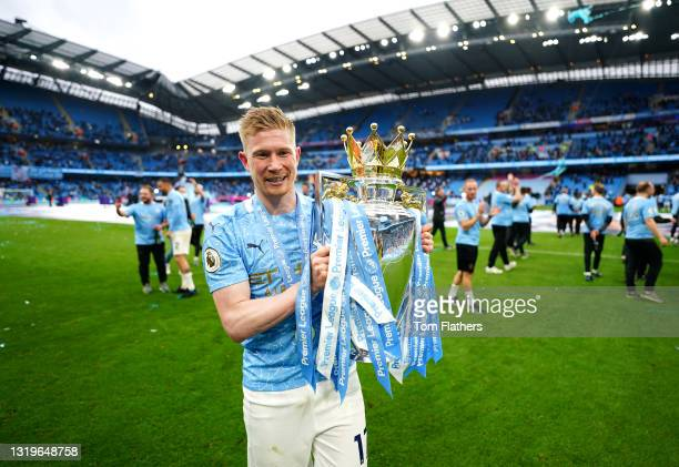Kevin De Bruyne of Manchester City celebrates with the Premier League Trophy as Manchester City are presented with the Trophy as they win the league...