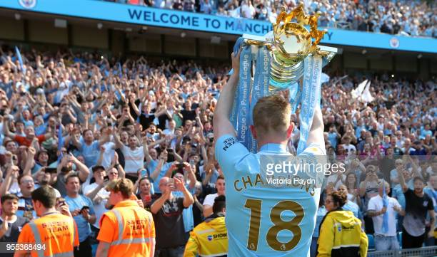 Kevin De Bruyne of Manchester City celebrates with The Premier League Trophy during the Premier League match between Manchester City and Huddersfield...