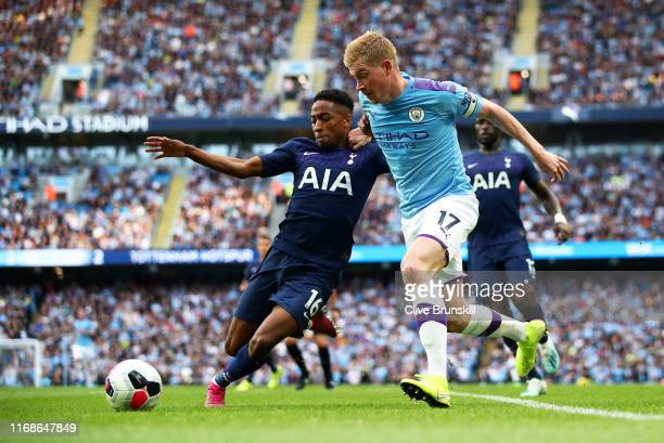 Kevin De Bruyne of Manchester City challenges for the ball with Kyle WalkerPeters of Tottenham Hotspur during the Premier League match between...