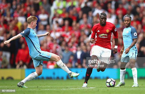 Kevin De Bruyne of Manchester City challenges Paul Pogba of Manchester United during the Premier League match between Manchester United and...