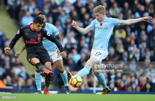 Kevin de Bruyne of Manchester City competes with Alexis Sanchez of Arsenal during the Premier League match between Manchester City and Arsenal at...