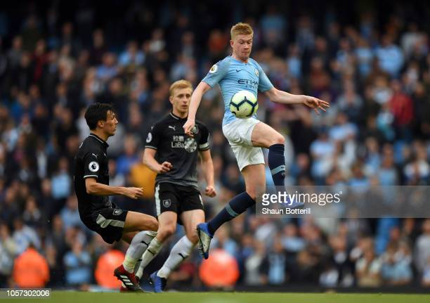 Kevin De Bruyne of Manchester City controls the ball as Jack Cork of Burnley looks on during the Premier League match between Manchester City and...