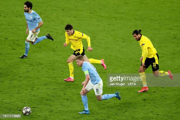 Kevin De Bruyne of Manchester City controls the ball from Giovanni Reyna and Emre Can of Borussia Dortmund during the UEFA Champions League Quarter...