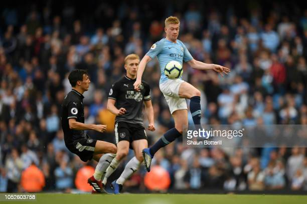 Kevin De Bruyne of Manchester City controls the ball while under pressure from Jack Cork of Burnley during the Premier League match between...