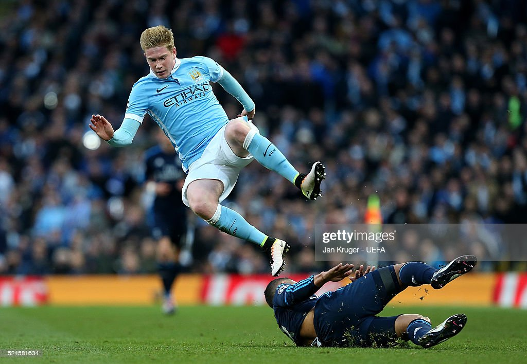 Kevin de Bruyne of Manchester City FC is tackled by Casemiro of Real Madrid during the UEFA Champions League semi final first leg match between Manchester City FC and Real Madrid on April 26, 2016 in Manchester, England.