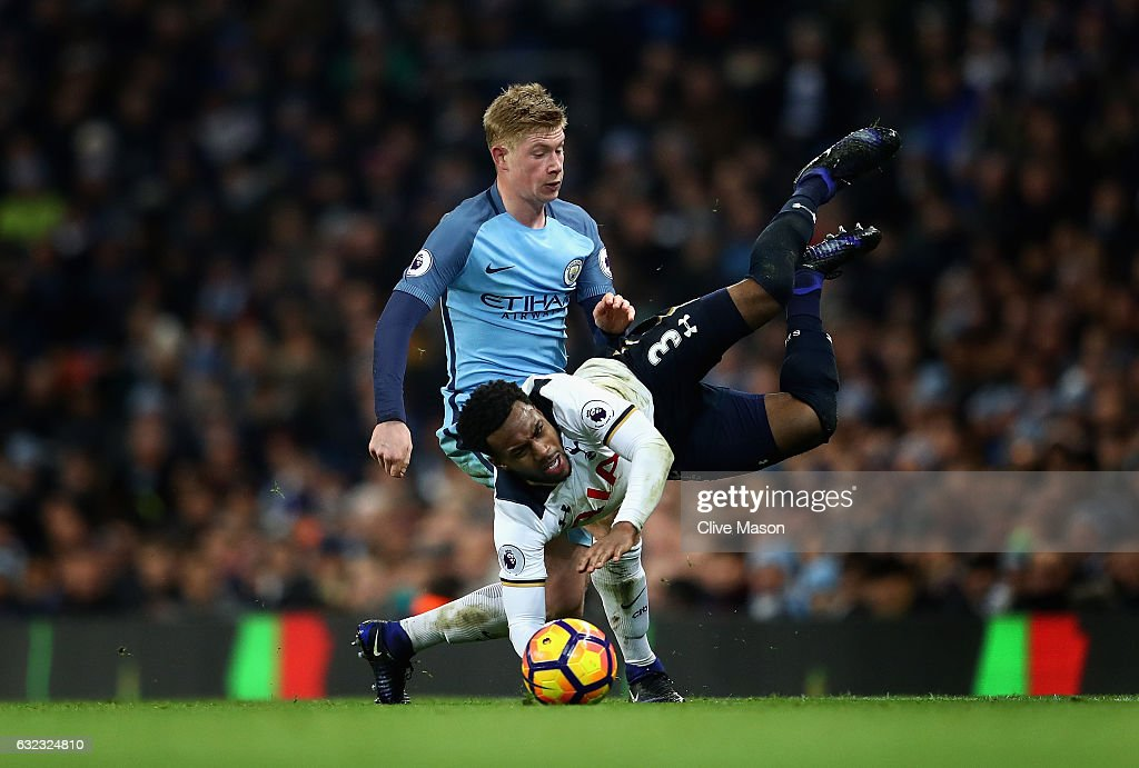 Kevin De Bruyne of Manchester City (L) fouls Danny Rose of Tottenham Hotspur (R) during the Premier League match between Manchester City and Tottenham Hotspur at Etihad Stadium on January 21, 2017 in Manchester, England.