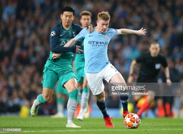 Kevin De Bruyne of Manchester City holds off a challenge from Heung-Min Son of Tottenham Hotspur during the UEFA Champions League Quarter Final...