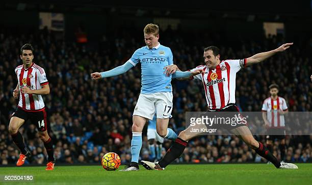 Kevin De Bruyne of Manchester City holds off the challenge from John O'Shea of Sunderland to score his team's fourth goal during the Barclays Premier...