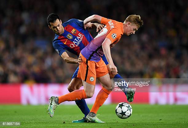 Kevin De Bruyne of Manchester City holds off the challenge of Sergio Busquets of Barcelona during the UEFA Champions League group C match between FC...