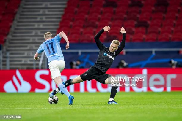 March 16: Kevin De Bruyne of Manchester City in action during the UEFA Champions League Round Of 16 Leg Two match between Manchester City and...
