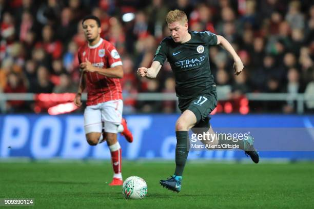 Kevin De Bruyne of Manchester City in action with Korey Smith of Bristol City during the Carabao Cup SemiFinal 2nd leg match between Bristol City and...