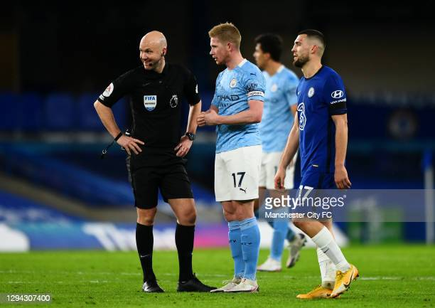 Kevin De Bruyne of Manchester City interacts with match referee, Anthony Taylor during the Premier League match between Chelsea and Manchester City...