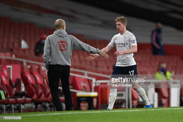 Kevin De Bruyne of Manchester City interacts with Pep Guardiola, Manager of Manchester City after being substituted during the Premier League match...