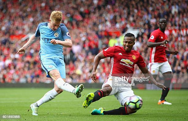 Kevin De Bruyne of Manchester City is challenged by Antonio Valencia of Manchester United during the Premier League match between Manchester United...