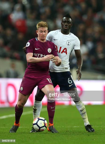 Kevin De Bruyne of Manchester City is challenged by Davinson Sanchez of Tottenham Hotspur during the Premier League match between Tottenham Hotspur...