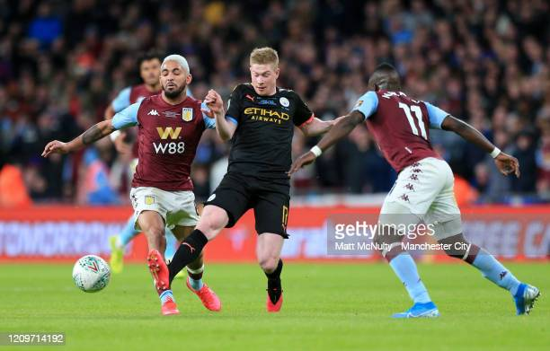 Kevin De Bruyne of Manchester City is challenged by Douglas Luiz of Aston Villa during the Carabao Cup Final between Aston Villa and Manchester City...