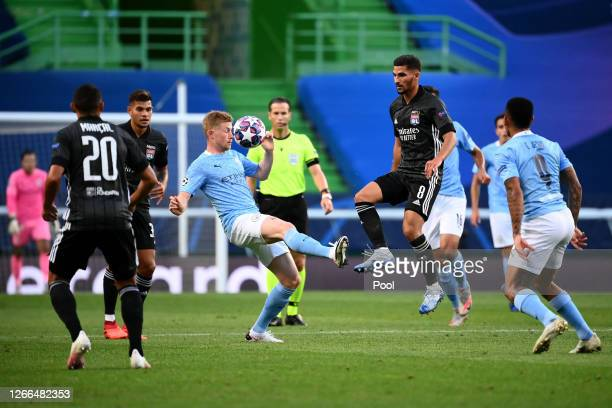 Kevin De Bruyne of Manchester City is challenged by Houssem Aouar of Olympique Lyon during the UEFA Champions League Quarter Final match between...