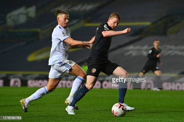 Kevin De Bruyne of Manchester City is challenged by Kalvin Phillips of Leeds United during the Premier League match between Leeds United and...