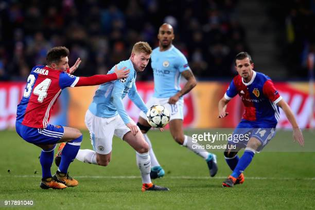 Kevin De Bruyne of Manchester City is challenged by Taulant Xhaka of FC Basel during the UEFA Champions League Round of 16 First Leg match between FC...
