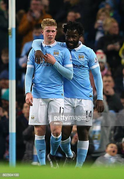 Kevin De Bruyne of Manchester City is congratulated by teammate Wilfried Bony of Manchester City after scoring his team's fourth goal during the...