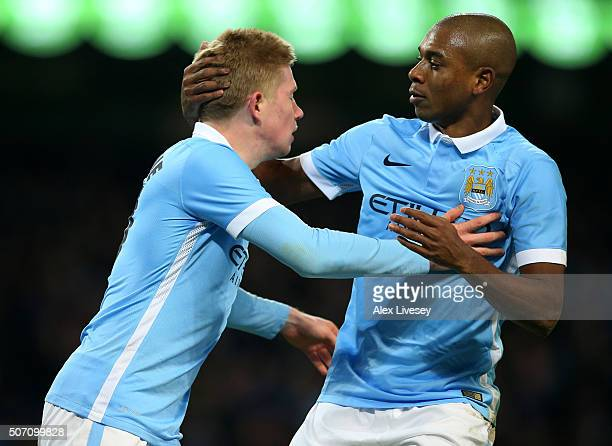 Kevin De Bruyne of Manchester City is congratulated by teammate Fernandinho after scoring his teams second goal during the Capital One Cup Semi Final...