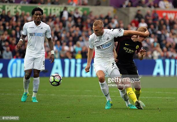 Kevin De Bruyne of Manchester City is fouled by Mike van der Hoorn of Swansea City for which a penalty kick was awarded during the Premier League...