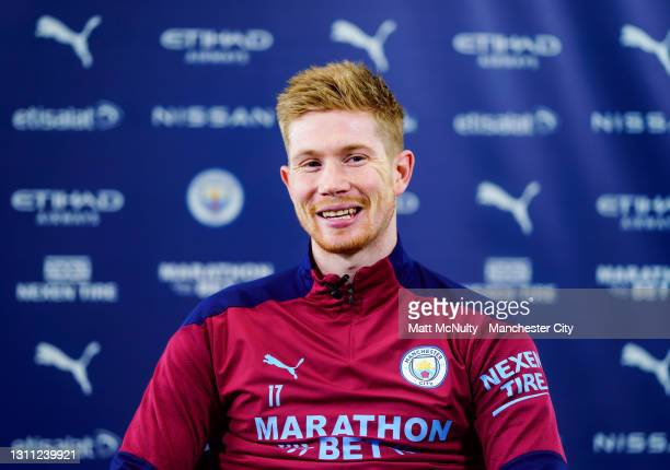 Kevin de Bruyne of Manchester City is interviewed by City TV after signing a new contract at the club at Manchester City Football Academy on April...