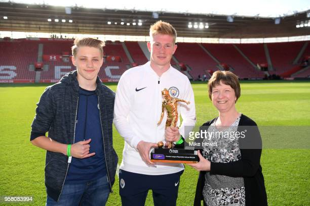 Kevin De Bruyne of Manchester City is presented with Premier League Golden Playmaker Award after the Premier League match between Southampton and...