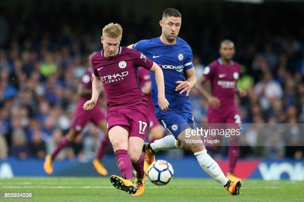 Kevin De Bruyne of Manchester City is put under pressure from Gary Cahill of Chelsea during the Premier League match between Chelsea and Manchester...