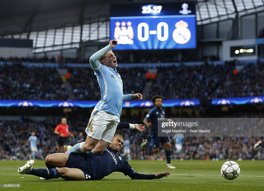 Kevin De Bruyne of Manchester City is tackled by Pepe of Real Madrid during the UEFA Champions League Semi Final first leg match between Manchester City FC and Real Madrid at the Etihad Stadium on April 26, 2016 in Manchester, United Kingdom.
