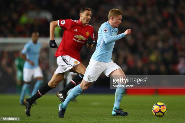 Kevin De Bruyne of Manchester City is tracked by Nemanja Matic of Manchester United during the Premier League match between Manchester United and...