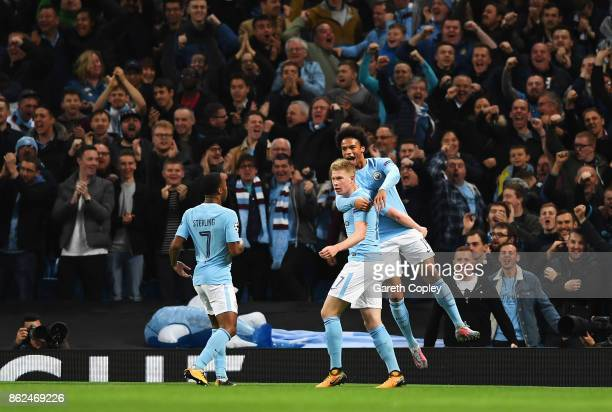 Kevin De Bruyne of Manchester City Leroy Sane of Manchester City celebrate with Raheem Sterling of Manchester City after he scores during the UEFA...