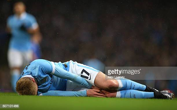 Kevin De Bruyne of Manchester City lies injured during the Capital One Cup Semi Final second leg match between Manchester City and Everton at the...