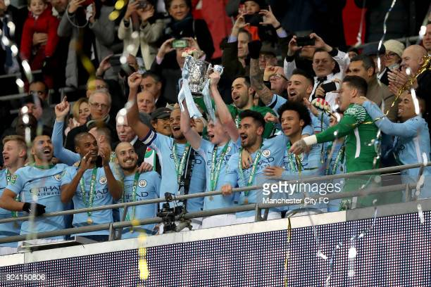 Kevin De Bruyne of Manchester City lifts the trophy after winning the Carabao Cup Final between the Arsenal and Manchester City at Wembley Stadium on...