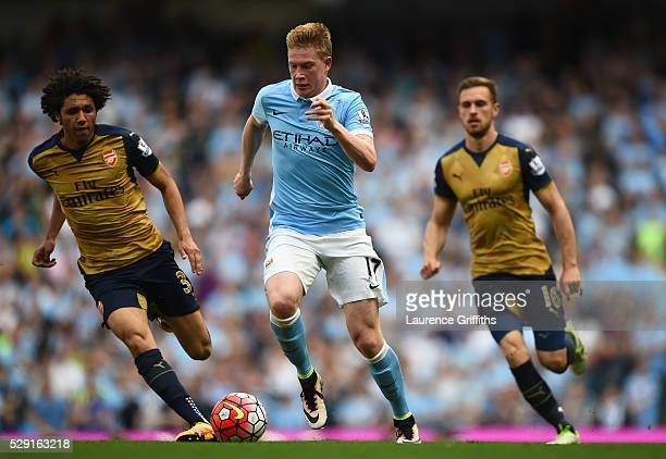 Kevin de Bruyne of Manchester City makes a break through the Arsenal defence to score his side's second goal during the Barclays Premier League match...