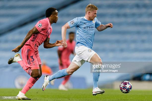 Kevin De Bruyne of Manchester City plays against Eder Militão of Real Madrid during the UEFA Champions League round of 16 second leg match between...
