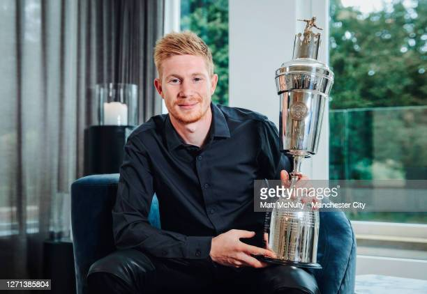 Kevin de Bruyne of Manchester City poses as he wins the PFA Player of the Year Award for the 2019/20 season at Manchester City Football Academy on...