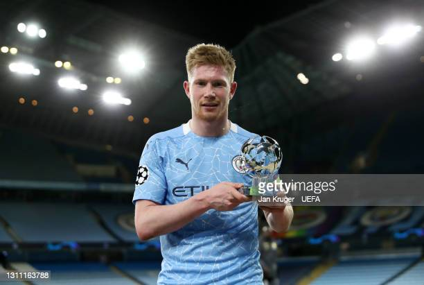 Kevin De Bruyne of Manchester City poses for a photo with the UEFA Player of the Match trophy following their victory in the UEFA Champions League...