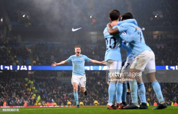 Kevin De Bruyne of Manchester City runs to join the celebrations after Raheem Sterling of Manchester City scored his sides fourth goal during the...