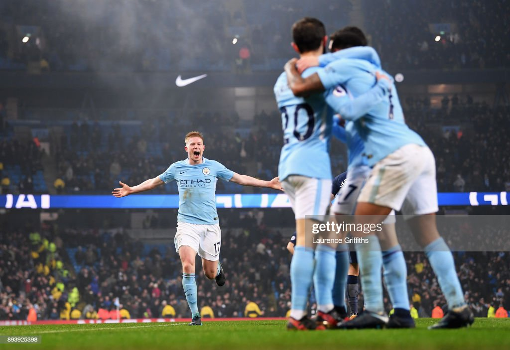 Kevin De Bruyne of Manchester City runs to join the celebrations after Raheem Sterling of Manchester City scored his sides fourth goal during the Premier League match between Manchester City and Tottenham Hotspur at Etihad Stadium on December 16, 2017 in Manchester, England.