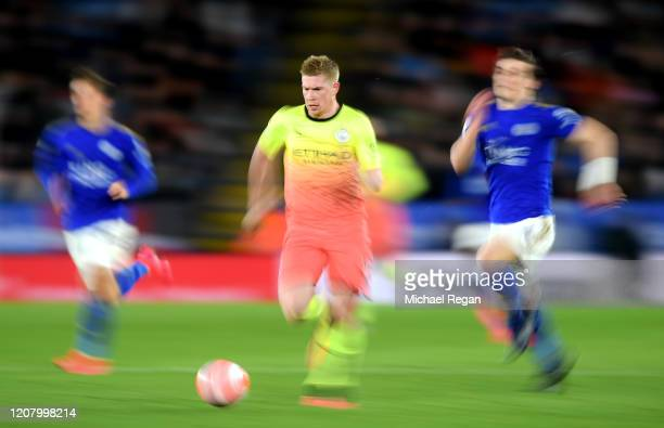 Kevin De Bruyne of Manchester City runs with the ball whilst being chased by Caglar Soyuncu of Leicester City during the Premier League match between...