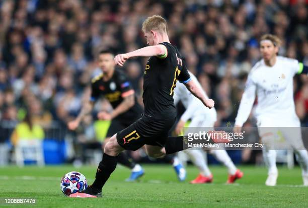 Kevin De Bruyne of Manchester City scores a penalty for his team's second goal during the UEFA Champions League round of 16 first leg match between...