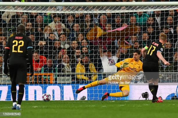 Kevin De Bruyne of Manchester City scores a penalty to make it 12 during the UEFA Champions League round of 16 first leg match between Real Madrid...