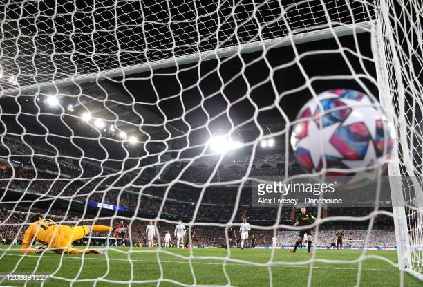 Kevin De Bruyne of Manchester City scores from the penalty spot past Thibaut Courtois of Real Madrid for their second goal during the UEFA Champions...