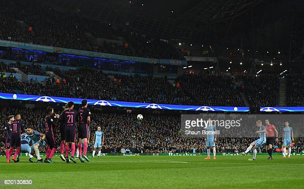Kevin De Bruyne of Manchester City scores his sides second goal from a freekick during the UEFA Champions League Group C match between Manchester...